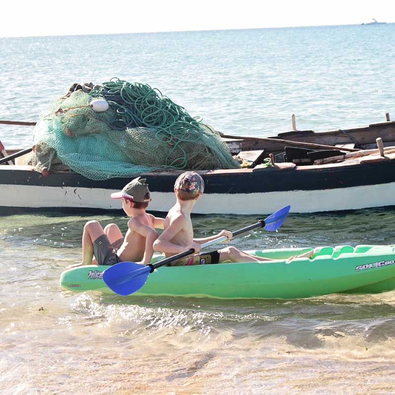 kids exploring the bay on a kayak