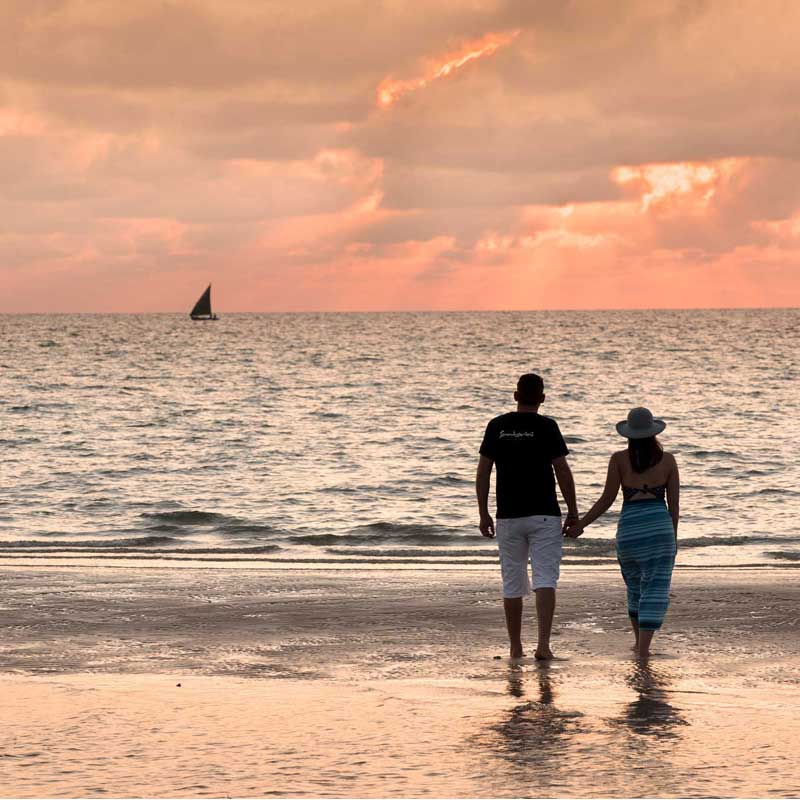 romantic setting of couple on the beach at sunrise